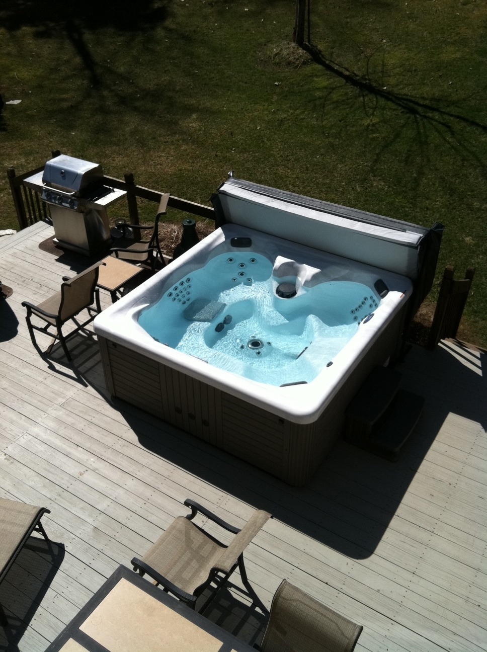 A hot tub next to the grill is perfect for the outdoor man cave