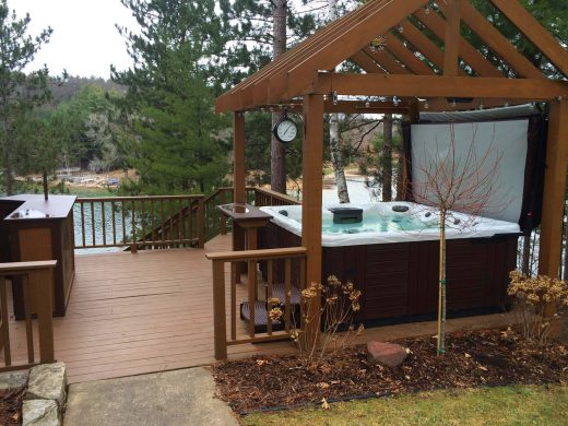 Create your outdoor man cave complete with gazebo and bar close by