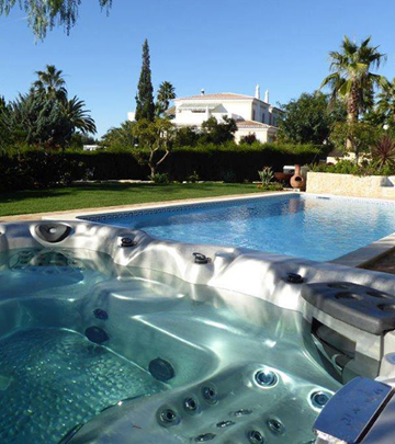 Backyard ideas for hot tubs and swim spas for Above ground pool decks las vegas