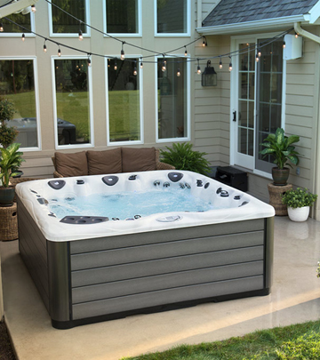 Prepare your backyard for hot tub installation by creating a concrete pad.