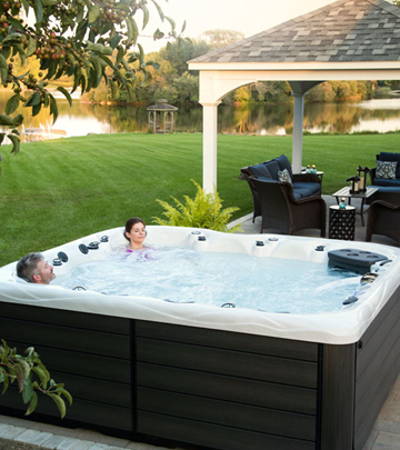 Master Spas hot tub near a gazebo in a backyard