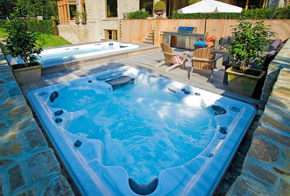 Backyard ideas for hot tubs and swim spas for Spa swimming pool