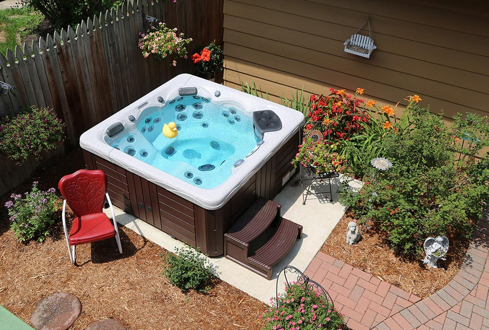 Overhead view of hot tub with garden landscaping