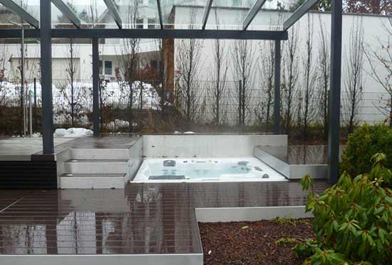 Hot tub recessed in wood deck with automated deck cover