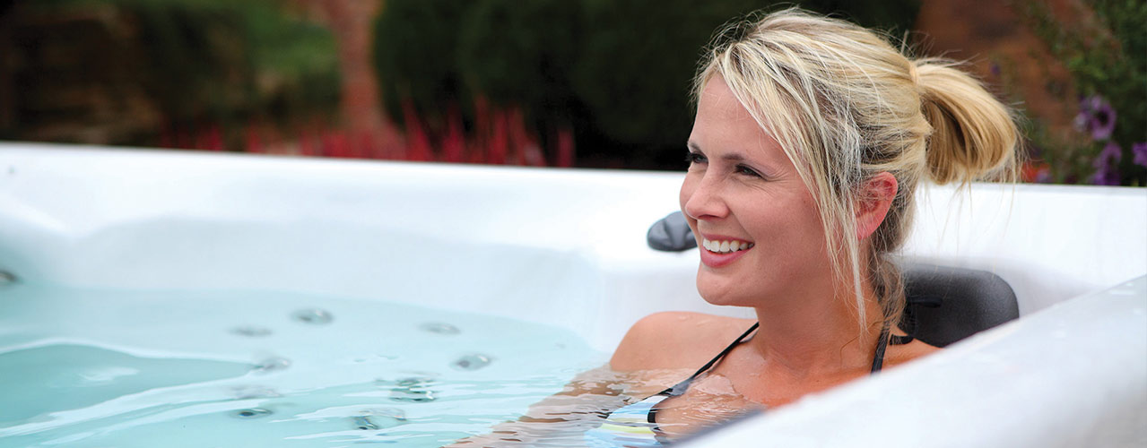Woman enjoying relaxing in a Clarity Spas hot tub