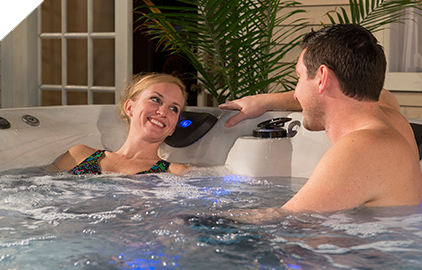 A couple enjoying a relaxing evening in a Legend series hot tub