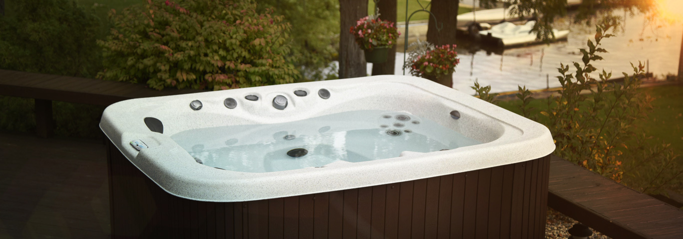 A family enjoying a getaway series hot tub by master spas