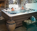 Couple enjoying their outdoor hot tub
