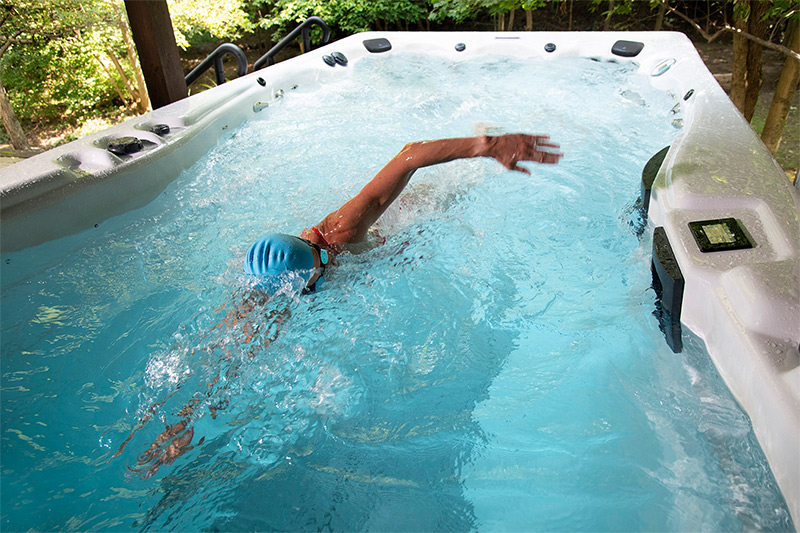 Meredith Kessler, IRONMAN champion, with an h2x swim spa by master spas
