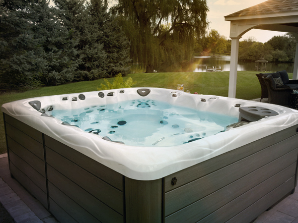 feel at home in your backyard paradise with a master spas hot tub